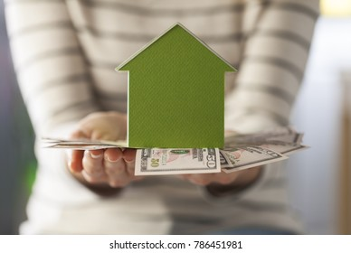 Mortgage concept by money house from the dollar cash