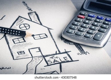 Mortgage concept. Calculating a loan. A calculator and image of a house or villa.