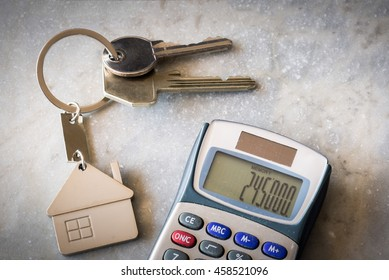 Mortgage concept. Calculator and keys representing or metaphor for home ownership and real estate.