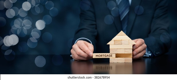 Mortgage concept. Financial agent complete wooden model of the house with last piece with text mortgage. Wide banner composition with bokeh background.