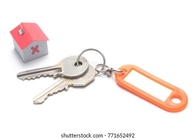 Mortgage concept: keys with plastic tag and a red paper house