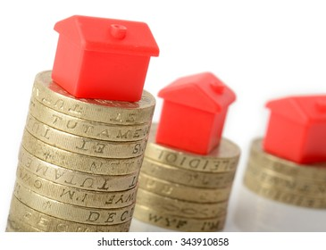 Mortgage concept small houses on stacks of coins
