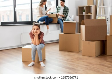 mortgage, family and real estate concept - sad girl moving to new home with mother and father packing things