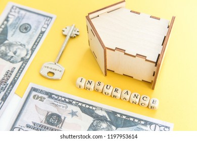 mortgage, insurance, loan and home purchase. Model of house, dollar bills, key on white and yellow isolated background. Free space for text, flat layout, flatlay