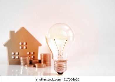 Mortgage loading and property document concept for real estate. Bulbs for lamps - idea Home finances, building savings and realty financing (investments) concept.