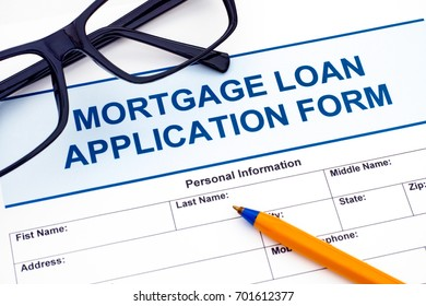 Mortgage Loan application form with ballpoint pen and glasses
