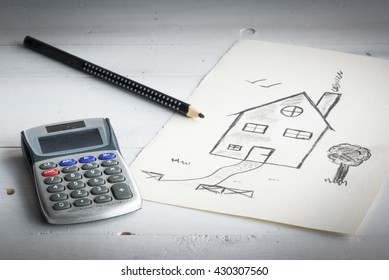 Mortgage or loan concept. A drawing of a house and calculator.