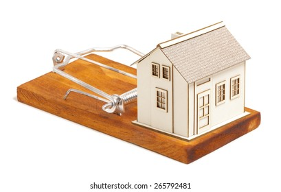 Mortgage payment concept. House on mousetrap isolated on a white background