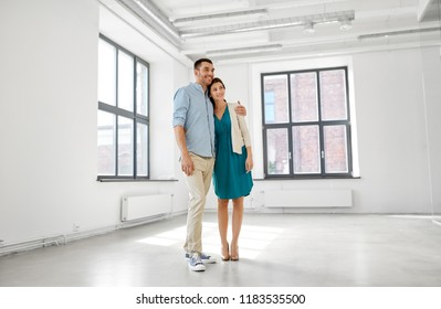 mortgage, people and real estate concept - happy couple at new home