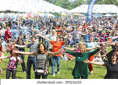 "Morton Grove, IL, USA - June 8, 2014: Confetti and streamers over the Greater Chicago Jewish Festival ""flash mob"" dancers performing an Israeli folk dance medley as part of the biennial outdoor event."