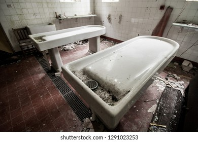Mortuary tables at an abandoned and derelict lunatic asylum/hospital (now demolished), Cane Hill, Coulsdon, Surrey, England, UK