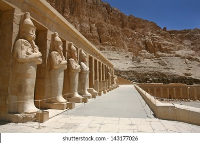 Mortuary Temple of Hatshepsut, near the Valley of the Kings, in Luxor, Egypt. A row of statues of Queen Hatshepsut as Osiris