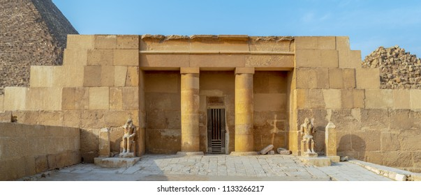 The Mortuary Temple Of Khufu at Giza Pyramid complex revealing part of the Pyramid of Khufu in the background, Giza, Great Cairo, Egypt