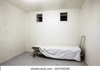 mortuary there is a space for the preservation of corpses with an iron bed