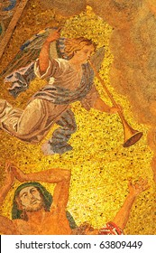 Mosaic of an angel with trumpet announcing the coming of God executed in golden mosaics