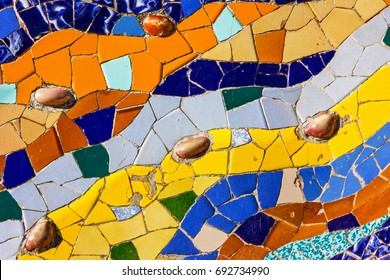 Mosaic ceramic tile, decoration in Park Guell, Barcelona, Spain. Designed by Gaudi
