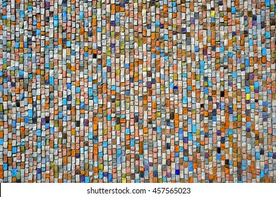 Mosaic of colorful stones on the wall, pattern, background, texture