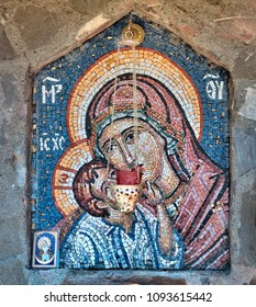 The mosaic icon of the Holy Virgin Mary and the child Jesus. Untried author. The source of holy water, the Serbian Orthodox Moraca monastery, Montenegro
