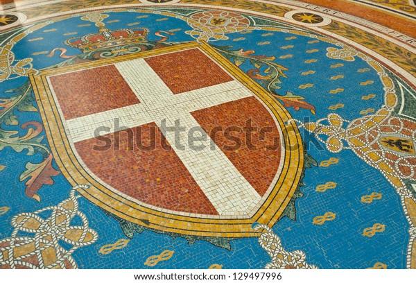 Mosaic on the floor of Galleria Vittorio Emanuele depicting Milan's coat of arms, Italy