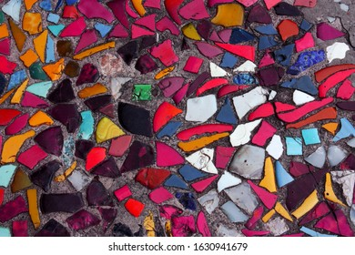 Mosaic pattern of multicolored broken tiles. Abstract pattern.