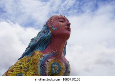 Mosaic sculpture of a goddess at Wat Ban Rai Buddhist temple in Dan Khun Thot