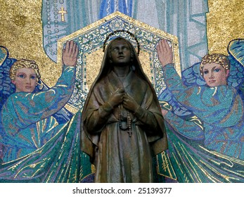 Mosaic of St Bernadette and the Virgin Mary outside the Basilica of the Rosary in Lourdes