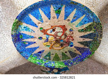 Mosaic sun medallion at the Parc Guell designed by Antoni Gaudi located on Carmel Hill, Barcelona, Spain.
