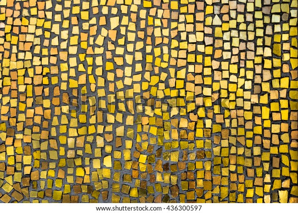 Mosaic tile background. Mosaic decoration in golden colors. Abstract texture of byzantine smalt in old tradition.