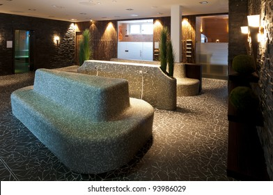 mosaic tiled sitting group for wellness with several sauna and steaming rooms arround, with atmospheric and impressive lightning