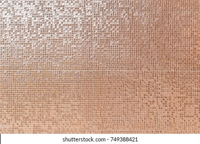 mosaic wall. A closed up pattern of mosaic wall in shiny orange for background or texture