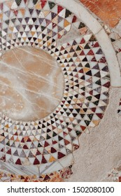 Mosaic Wall Decorative Ornament from Ceramics Broken Tile CloseUp. Circular Geometric Construction of Colorful Details Concept. Macro Photo of Beautiful Antique Architecture Background