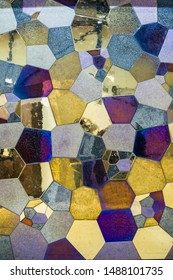 Mosaic wall decorative ornament from colorful glass an ceramic tiles. Abstract geometric mirror tiles on the wall.