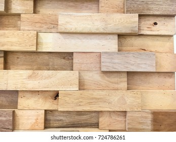 Mosaic of wood piece used for wall decoration shown as rough and beautiful pattern on wall