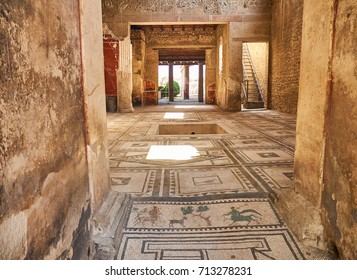 Mosaics at entrance of archaeological remains of Domus di Paquio Proculo in Ruins of Pompeii. The city was an ancient Roman city destroyed by the volcano Vesuvius. Campania, Italy.