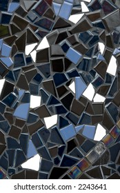Mosaique tiles - some matte, some opalescent in shades of blue, black, grey and white.