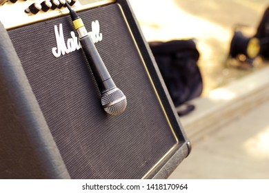 Moscow 06/06/2019 Street musicians using old school musical equipment outdoors. Close up of Marshall Kilburn and SURE microphone