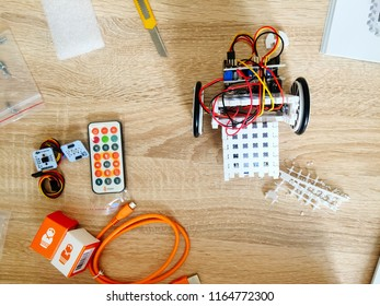 Moscow 1 July 2018: STEM or DIY Electronic Kit , Line tracking robot competition ideas closeup. Robot assembly with robot engineer electronic. Robot building kit above view STEM Education robotics