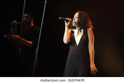 MOSCOW - 1 MARCH, 2015 : De Phazz music band performing live concert at Yotaspace nightclub.Vocalist singing in microphone on stage of night club.Live music performance show.Singer sing song on scene
