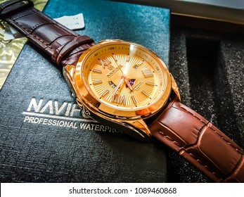 Moscow, 1 May 2018: Gold watch with leather wrist. Luxury Golden watch in a gift box. luxury man clock in gift box