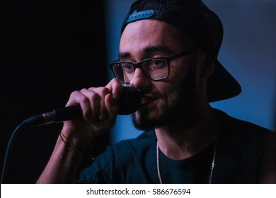 MOSCOW - 1 NOVEMBER,2015: Portrait of famous Russian rap singer Mot performing live event in night club at presentation of hip hop magazine Rhyme.Popular hip hop artist sing on party in nightclub
