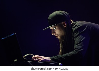 MOSCOW - 10 NOVEMBER,2015: Freak party Dj DKay play music on stage in night club.Cool young man with fashion eye lenses and face piercing playing music on party in nightclub.Concert event background