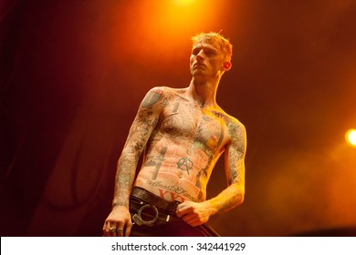 MOSCOW - 10 NOVEMBER,2015 : MGK with microphone on stage in nightclub.Colson Baker known as Machine Gun Kelly presents his new album General Admission in Yotaspace club.