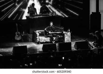 MOSCOW - 11 APRIL,2015: Guitarist play on stage on concert of rapper Kravz in night club.Professional adult guitar player playing on scene.Night entertainment event background