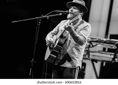 MOSCOW - 12 February,2015:Big concert of popular British singer Alex Clare sing on scene in night club.Famous guitar player and singer performing live on stage.Nightclub concert,entertainment event