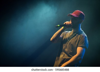 MOSCOW - 12 FEBRUARY,2017: Big rap concert of Waka Flocka Flame rap star in night club.Russian warm up artists on stage.Bright concert lighting on scene.Young white hip hop singer with microphone