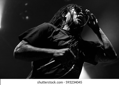 MOSCOW - 12 FEBRUARY,2017: Famous hip hop singer Waka Flocka performing live music show on stage.Bright concert lighting on popular rapper.Cool braided African American singer with microphone on scene