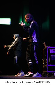 MOSCOW - 12 JULY,2017: Popular Russian rap singer Husky performing on stage in night club.Hip hop performer on scene in the club.Entertainmentevent with live music show