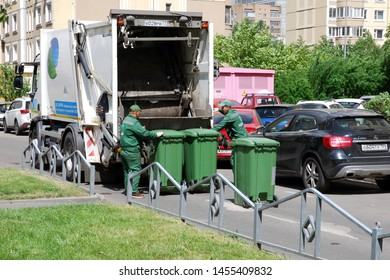 Moscow 12/06/2019 Garbage collection workers in residential area. Garbage truck  used for rubbish disposition. Separate garbage collection problem, household waste recycling.