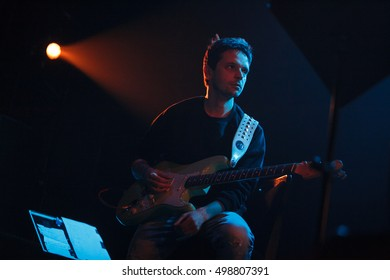 MOSCOW - 13 OCTOBER,2016 : Russian rap music concert in night club.Hip hop band guitarist performing on stage of nightclub Yotaspace.Electric guitar player playing on scene