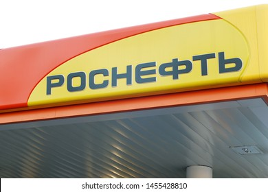 Moscow 13/06/2019 Close up of Rosneft oil producing company. Big company logo on roof of petrol station